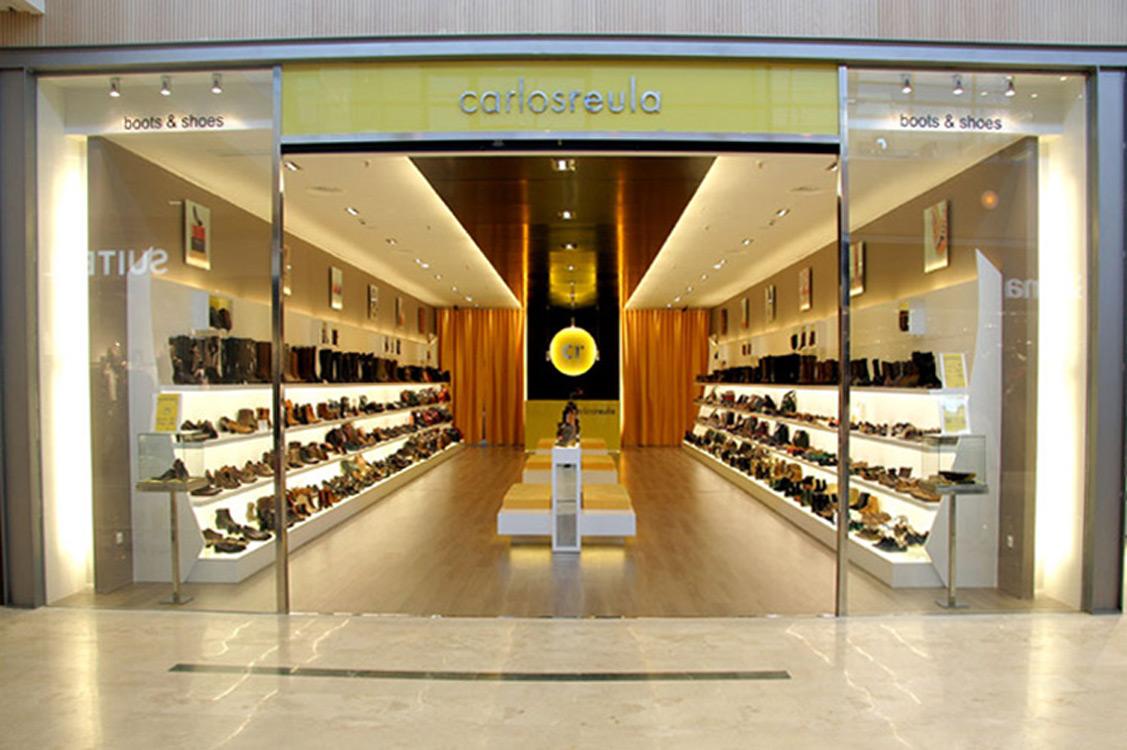 N&N. Interiorismo y decoración. Tienda de calzado Carlos Reula, Puerto Venecia, Zaragoza